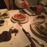 Two filets (left), a ribeye (right), and a NY strip (not pictured). With Mac & cheese, asparagus