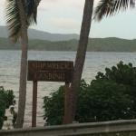 Roadside sign for restaurant looking towards the bay.