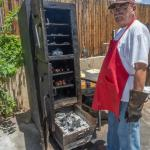 The owner with his homemade smoker