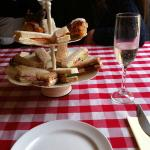 Finger sandwiches, home-made and warm sausage rolls and a glass of Prosecco!