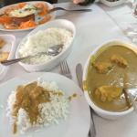 The crab and king prawn curry - in the background the traditional Portuguese sausage with egg an