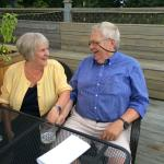 My wife Meg and I enjoying a snack on the deck at Riso
