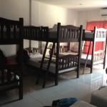 The 8 bed dorm; 3 bunk beds and 2 single beds w/ air con.