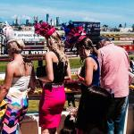 Colourful girls on magic millions day