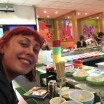 My sis enjoying sushi!