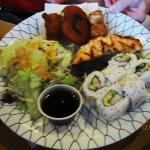 Grilled salmon, croquette, chicken, California roll, salad