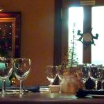 Well set tables & seasonal decorations.