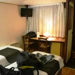 Twin room, slender beds, small space.