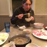 Eating the noodles from the hot pot