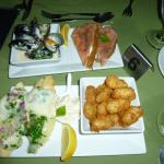 Tapas from top eft mussels, top right salmon on bread, bottom left manchego - toasted montage wi