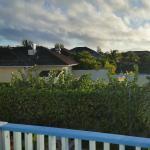 view of neighbor resort from doorway into villa