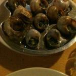 escargots con echalote, perejil y mantequilla, como en Paris.