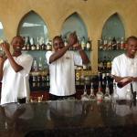 Three of the barmen having fun making cocktails.