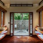 Beachfront bure bathroom with outdoor shower