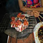 BBQ at the table over hot coals