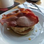 Homemade Scotch pancakes with bacon and maple syrup