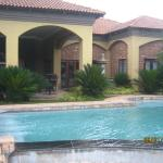 Swimming pool next to patio and spa