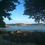view of beach walking between bungalows