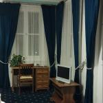 Guest Room:  Plenty of Windows with Elegant Drapes
