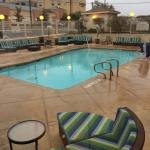 Outdoor pool and neighboring Courtyard Inn