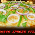 Paneer Xpress Pizza is a very Indian Pizza, the Marinated Mined Paneer with Onions and Capsicum