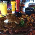 Breakfast of french toast, home fries, and a fuzzy navel