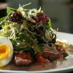 Steak Salad with soft poached egg, tomato, red onion, blue cheese, & yogurt/mustard vinaigrette