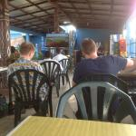 Customers watching soccer at the lower terrace
