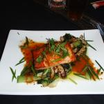 Grilled salmon with asian vegetables and mushrooms.
