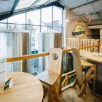 Upstairs of the bar area with imposing stainless steel brewing vessels