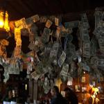 Bar area with many, many autographed dollar bills