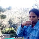 My wife having tea in d middle of tea garden