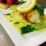Parma wrapped cod with fondant potatoes, cherry tomatoes and chive sauce.