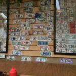 The walls are lined with money. You decorate one and  put it on the wall.