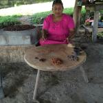 Adalia explaining the types of cacao beans.