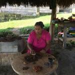 Adalia, Eladio and Virginia's eldest daughter, creating the cacao nibs.