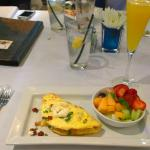 My yummy omlet, fresh fruit and mimosa