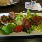 The marinated meat is excellent at Happy Hour