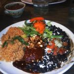 cheese enchilada with rojo sauce and black beans