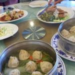 Pork xiao long bao, pork and crab meat xiao long bao, pork chop rice, stinky tofu and egg rolls