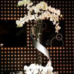 Gorgeous floral arrangement against the black and gold accents of the Edison Ballroom