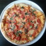 Pizze with fresh Mozzarella, Basil, Cherry Tomato, Tomato Sauce and Olive Oi