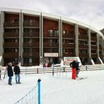 The apartments are adjacent to the slopes, not the hotel