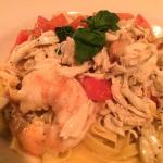 Shrimp and crab over linguine in white wine sauce