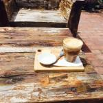 Latte on the lovely rustic outdoor seats!