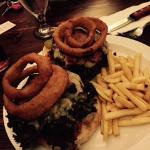 Delicious Burger (doubled up) with onion rings and french fries