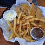 Chicken tenders and fries with small side of corn slaw