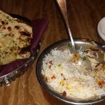 Chicken byriani and garlic nan (bread)