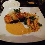 Scallops with fish salt crust over peanut purple rice with green papaya salad and panang curry