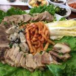 steamed pork, radish kimchi and raw oysters